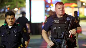 DALLAS, TX - JULY 7:  Dallas police stand near the scene where four Dallas police officers were shot and killed on July 7, 2016 in Dallas, Texas. According to reports, shots were fired during a protest being held in downtown Dallas in response to recent fatal shootings of two black men by police - Alton Sterling on July 5, 2016 in Baton Rouge, Louisiana and Philando Castile on July 6, 2016, in Falcon Heights, Minnesota. (Photo by Ron Jenkins/Getty Images)