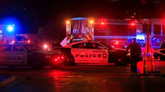 DALLAS, TX - JULY 8:  Dallas police work near the scene where eleven Dallas police officers were shot and five have now died on July 8, 2016 in Dallas, Texas. According to reports, shots were fired during a protest being held in downtown Dallas in response to recent fatal shootings of two black men by police - Alton Sterling on July 5, 2016 in Baton Rouge, Louisiana and Philando Castile on July 6, 2016, in Falcon Heights, Minnesota. (Photo by Ron Jenkins/Getty Images)