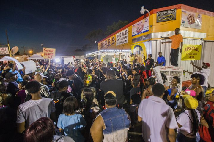 Protesters gather in front of the convenience store where Alton Sterling was shot and killed, July 6, 2016 in Baton Rouge, Lo