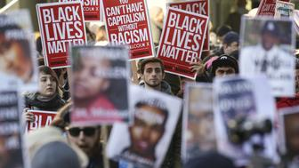 Black Lives Matter protesters gather in Westlake Park near Westlake Mall during Black Friday in Seattle, Washington November 27, 2015. REUTERS/David Ryder