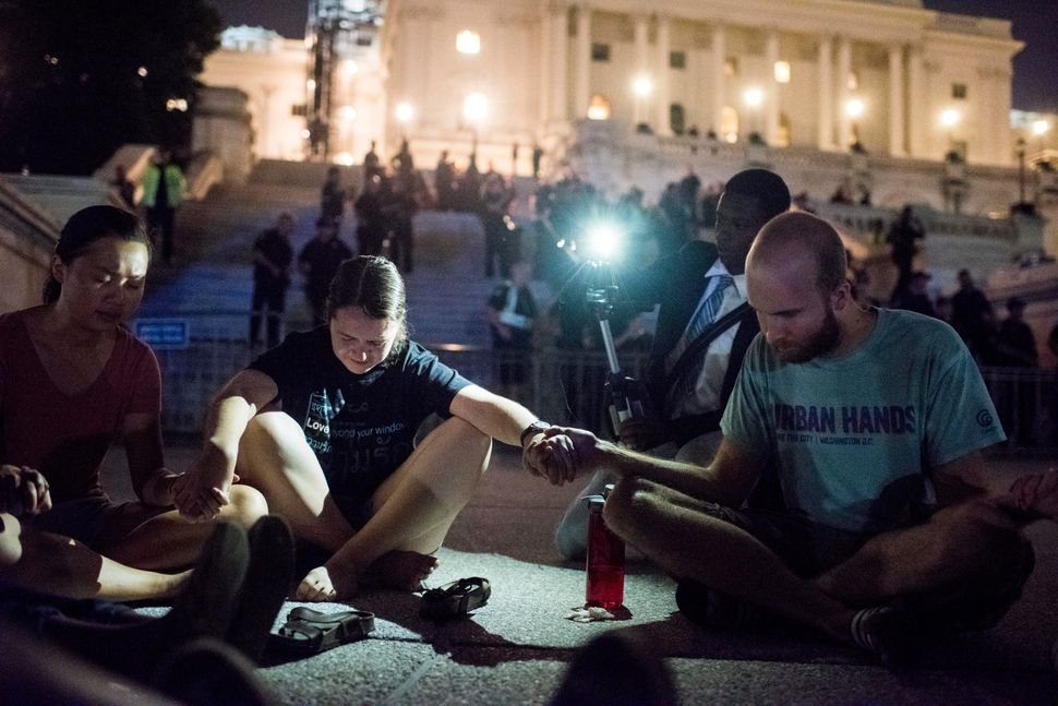 On the steps of the U.S. Capitol, Black Lives Matter protesters make their concerns known during a nighttime protest in Washi