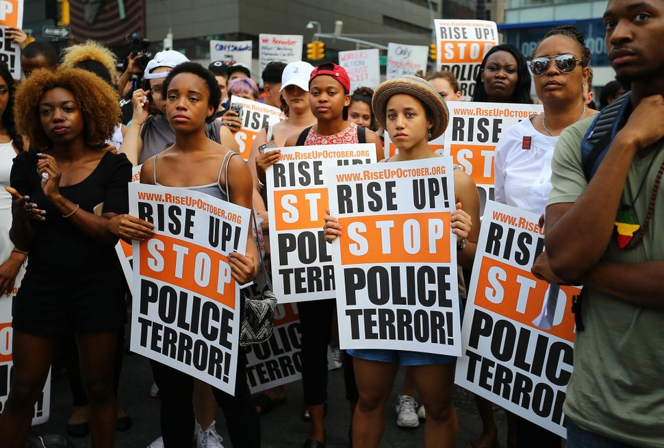 People hold banners and chant slogans as they march from Union Square Park to Grand Central in New York City.