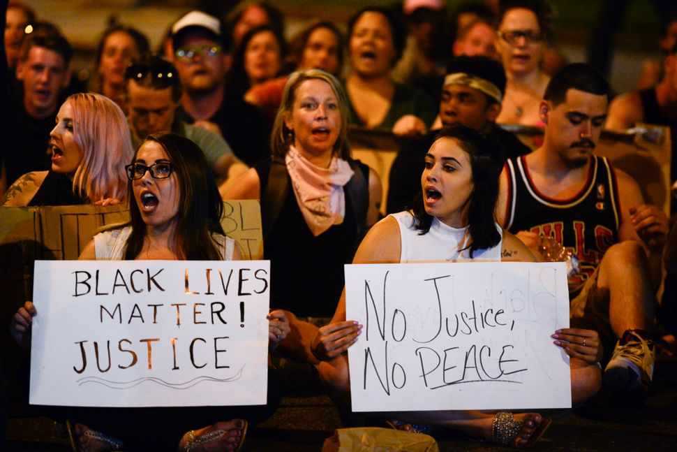 Protesters chant during a sit-in on Lincoln Avenue in solidarity with the Black Lives Matter movement in New York City.