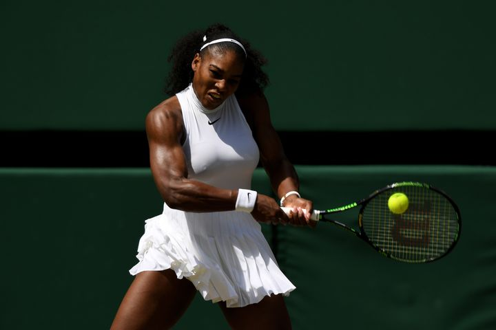 Williams plays a backhand.