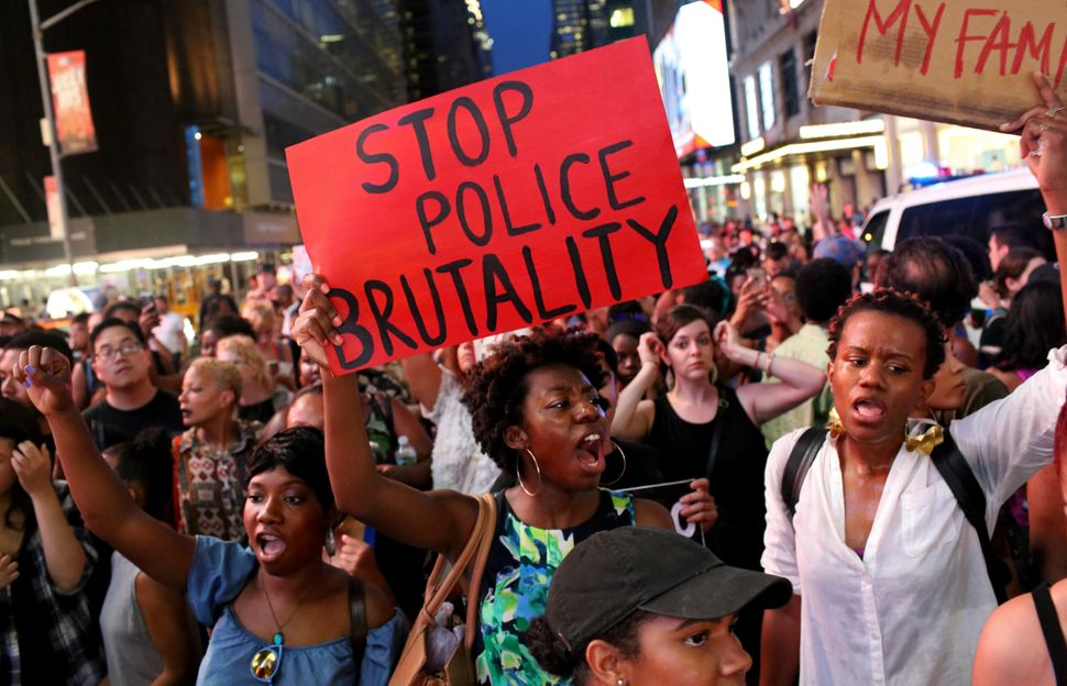 Activists protest in Times Square in response to the recent fatal shootings of black men by police.