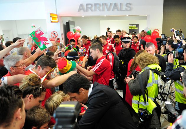 The Wales team arrive at Cardiff Airport to a heroes welcome after their historic performance at Euro