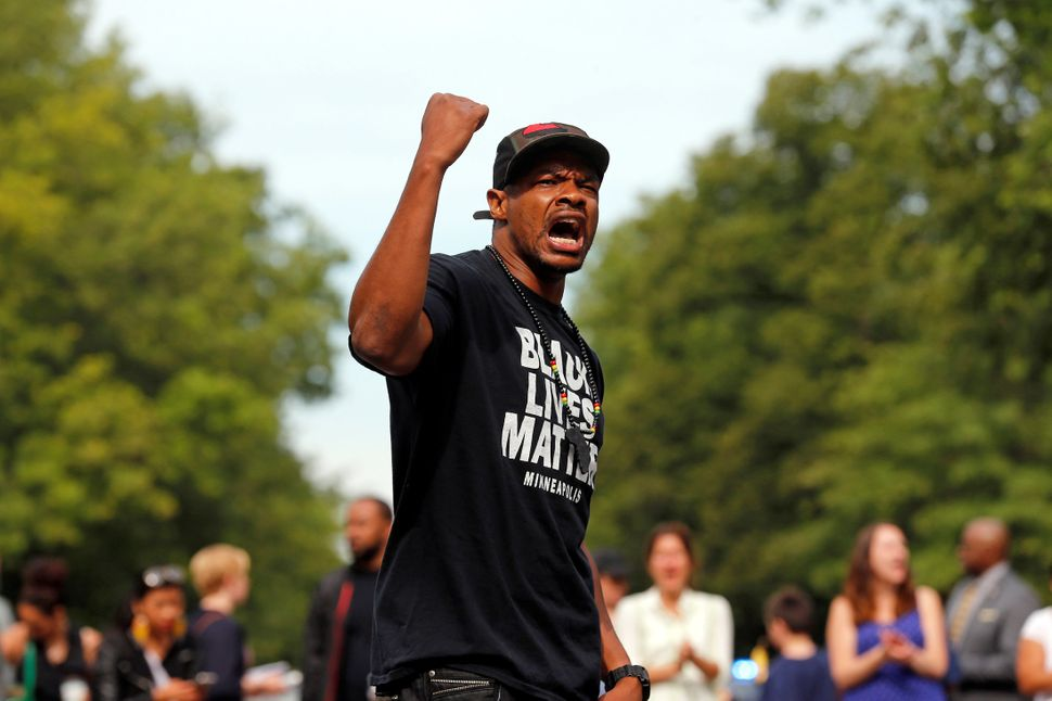 Marques Armstrong chants in support of Philando Castile in front of the governor's mansion in St. Paul, Minnesota.