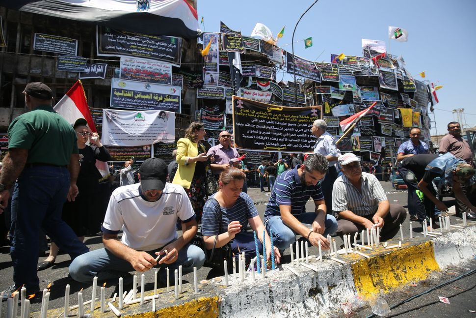 Candles pictured in front of a memorial to the victims at the site of the attack.