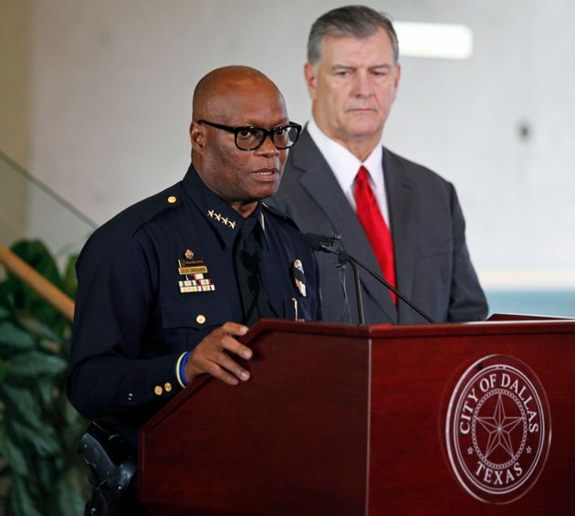 Dallas Police Chief David Brown speaks in front of Dallas Mayor Mike