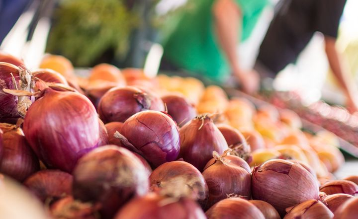 These red onions at a Sacramento farmers market show how beautiful produce can be, regardless of its shape.