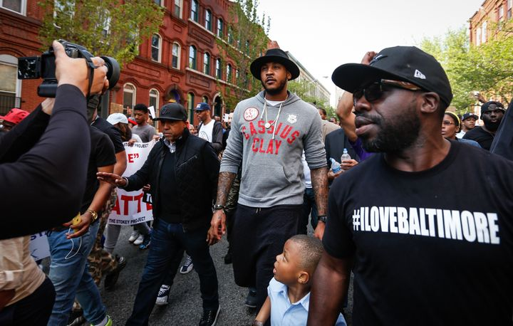 Carmelo Anthony is seen marching on Baltimore City Hall on April 30, 2015, after the death of Freddie Gray.