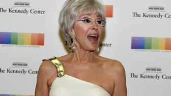Kennedy Center honoree Academy Award-winning actress and singer Rita Moreno poses for photographers as she arrives for a gala dinner at the U.S. State Department in Washington, December 5, 2015. The honors are bestowed annually on five artists for their lifetime achievement in the arts and culture.         REUTERS/Mike Theiler