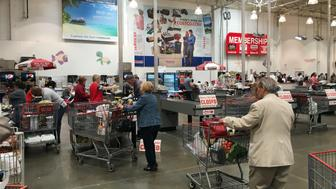 People are seen inside shopping at a Costco Wholesale warehouse club in Westbury, New York, U.S., May 23, 2016.  REUTERS/Shannon Stapleton