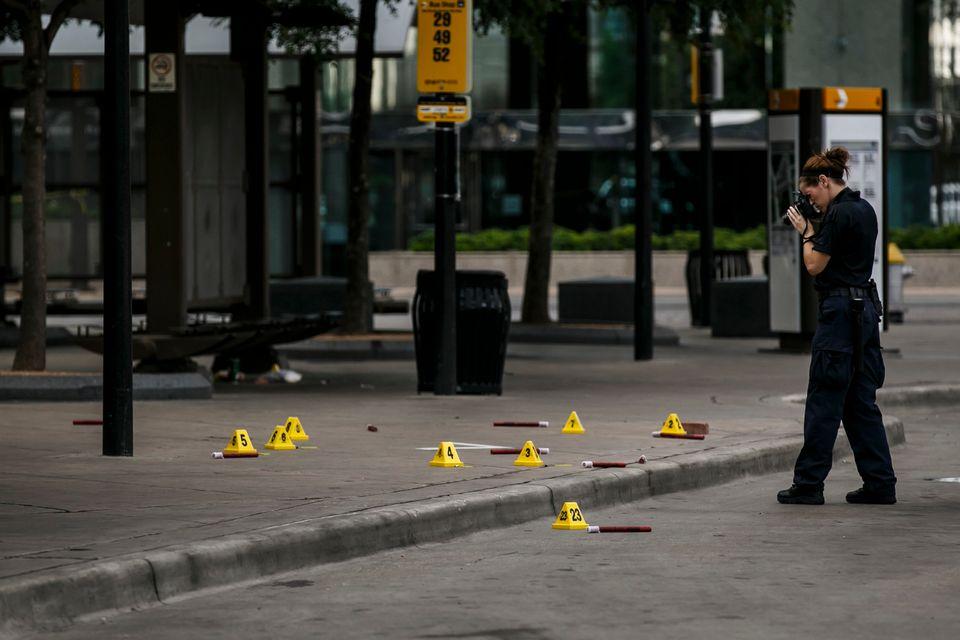 Investigators document the crime scene outside El Centro College.