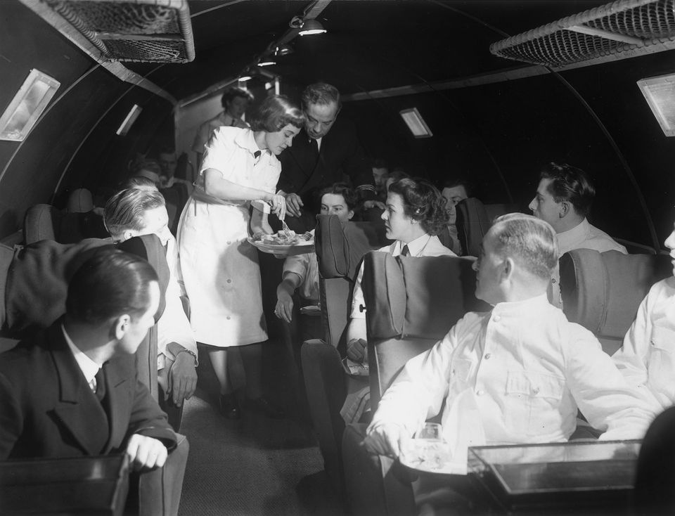 19th January 1950:  Trainee air hostess, Claire Swan, during a training session in a BOAC mock aircraft.