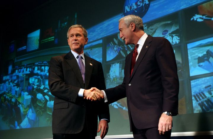 <em>NASA administrator Sean O'Keefe shakes hands with President Bush at NASA Headquarters in January 2004, where Bush unveiled a new vision for the nation's human spaceflight program in the wake of the Columbia accident. </em>