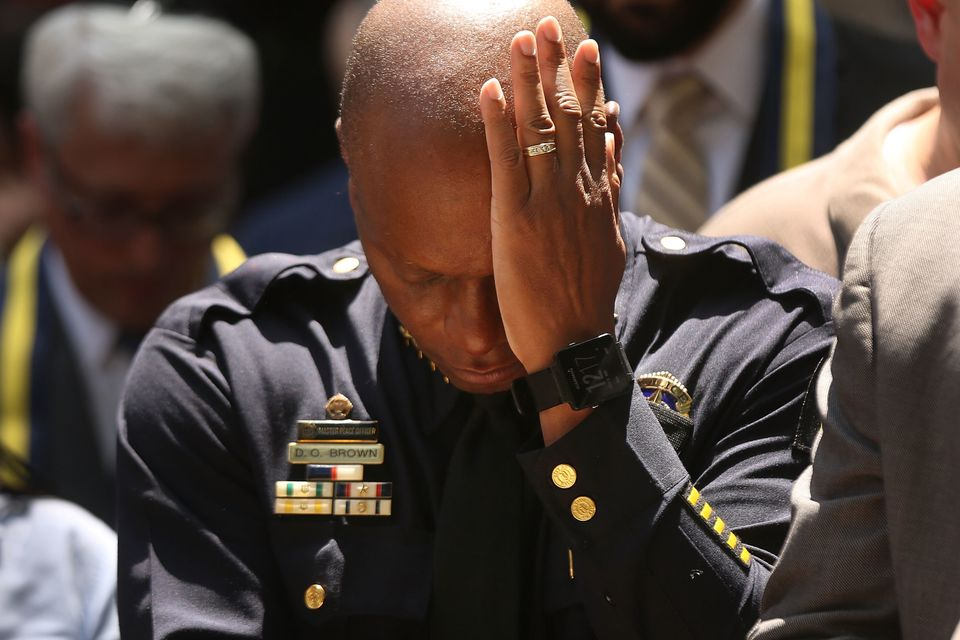 Dallas Police Chief David Brown pauses at a prayer vigil following the deaths of five police officers last night during a Bla