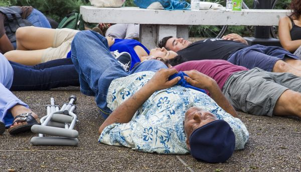 Fifty New Orleans residents participated in a die-in at the New Orleans Police Department in New Orleans, Louisiana on July 8