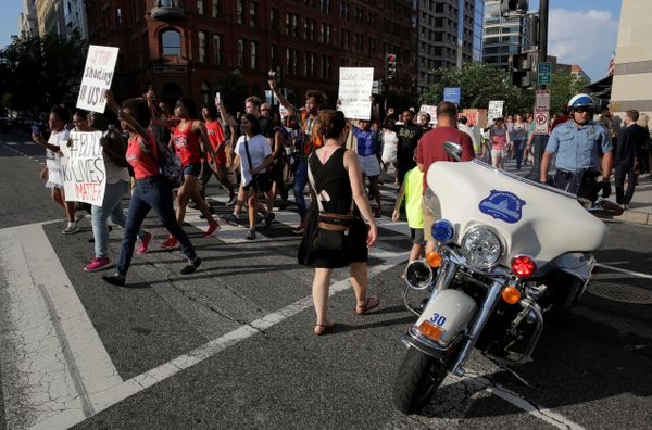 A Metropolitan police officer blocks traffic for Black Lives Matter protesters during a rally in Washington, U.S., July 8, 20