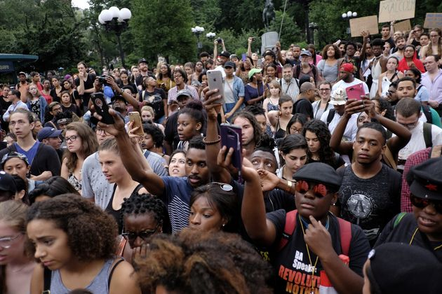 People take part in a protest against the killing of Alton Sterling, Philando Castile and in support...