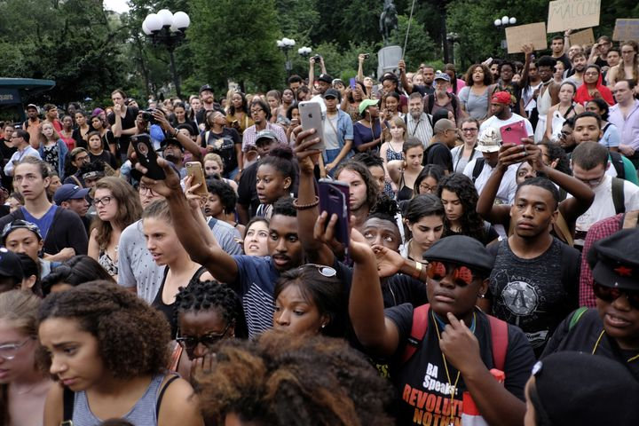 People take part in a protest against the killing of Alton Sterling, Philando Castile and in support of Black Lives Matter du