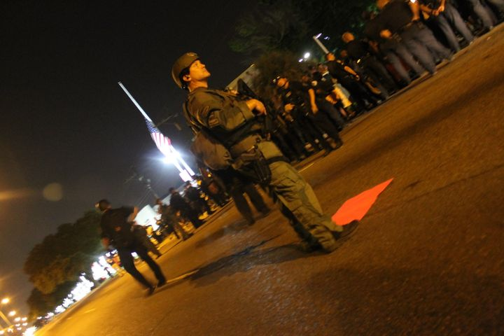 Police in tacticalgear face down protesters in Baton Rouge on Friday.
