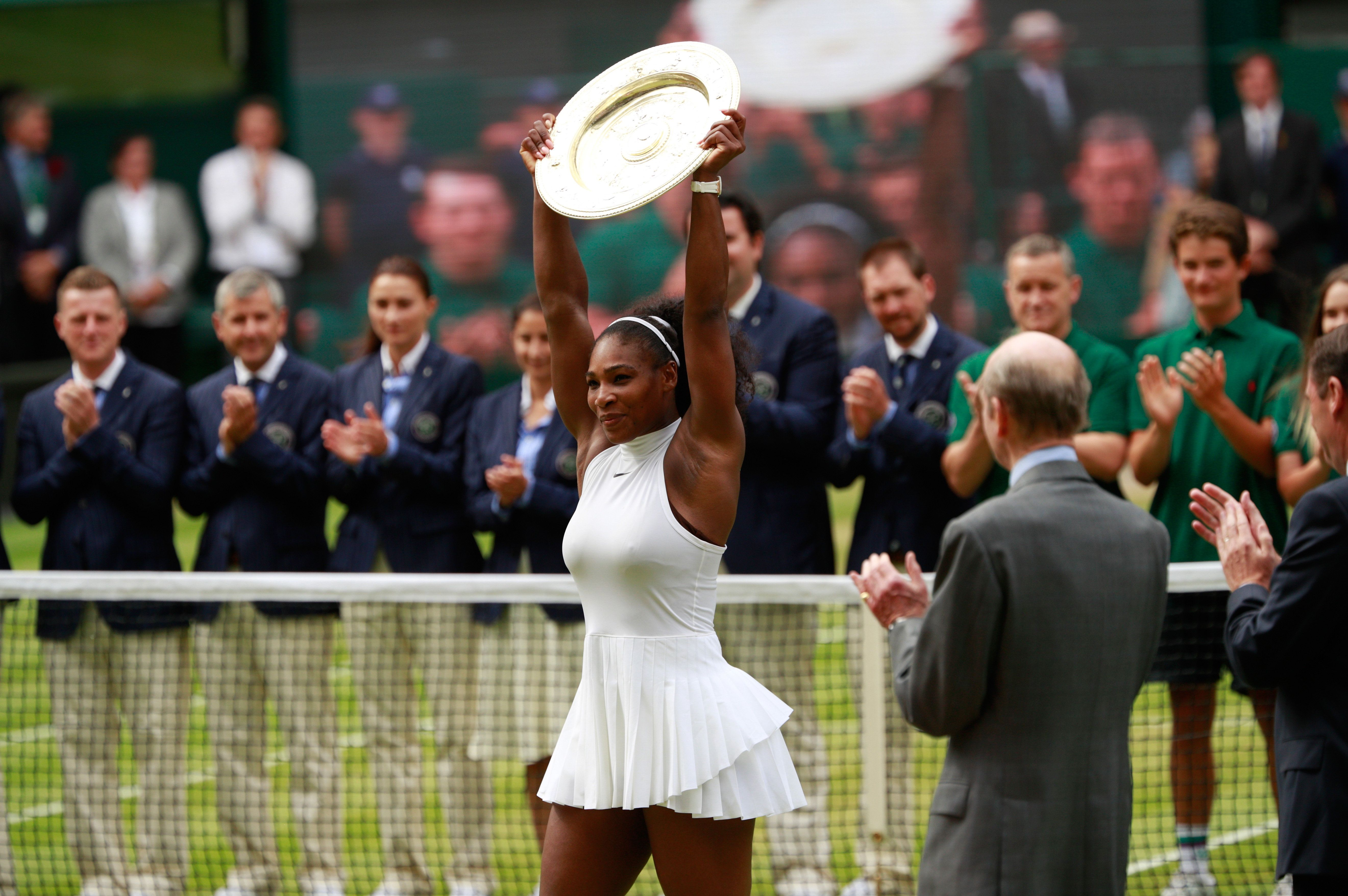 LONDON, ENGLAND - JULY 09:  Serena Williams of The United States lifts the trophy following victory in The Ladies Singles Final against Angelique Kerber of Germany on day twelve of the Wimbledon Lawn Tennis Championships at the All England Lawn Tennis and Croquet Club on July 9, 2016 in London, England.  (Photo by Adam Pretty/Getty Images)