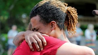 """Tyree Johnson, cousin of Philando Castile who was fatally shot by police during a traffic stop, is consoled by one of Castile's co-workers at a """"Black Lives Matter"""" demonstration in front of the Governor's Mansion in St. Paul, Minnesota, U.S., July 7, 2016.  REUTERS/Eric Miller"""