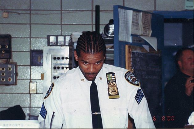 Corey Pegues, a former NYPD officer, shows off his corn rows after being promoted to
