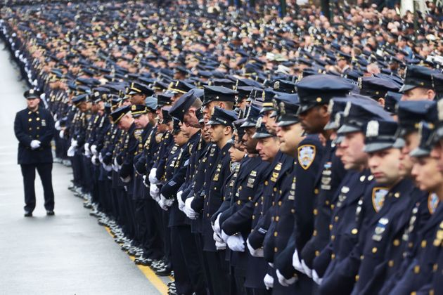 Police officers gather for the funeral of NYPD Officer Wenjian Liu. Liu and his partner, Rafael Ramos,...