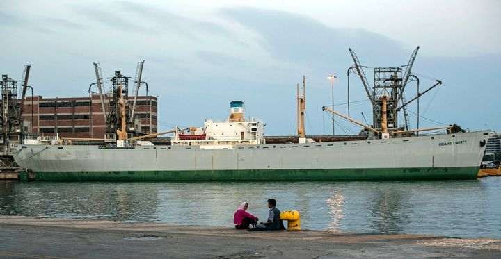 An Afghan couple sit waiting out the end of the day at the docks of Athens' port of Piraeus. They have spent approximat