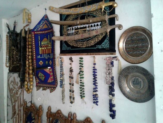 Antique decorative objects hang on the wall in Abu Abdo's shop. Eastern Ghouta, June,