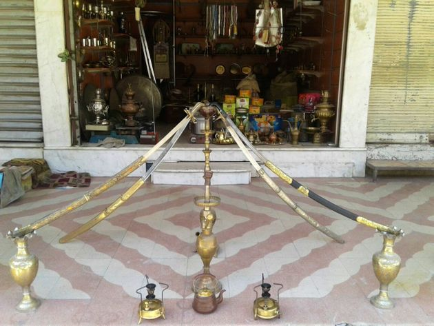 A 100-year-old hookah bowl with four ancient swards on display in front of Abu Abdo's shop. Eastern...