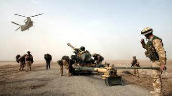 (FILES) A 105mm gun is dropped by a Chinook helicopter to British 29 Commando Regiment Royal Artillery on the Fao Peninsula in southern Iraq, on March 21, 2003. A long-awaited public inquiry into Britain's role in the Iraq war opened on November 24, 2009, six and a half years after then premier Tony Blair led Britain in backing the US-led invasion to oust Saddam Hussein.        AFP PHOTO/STEPHEN HIRD (Photo credit should read STEPHEN HIRD/AFP/Getty Images)
