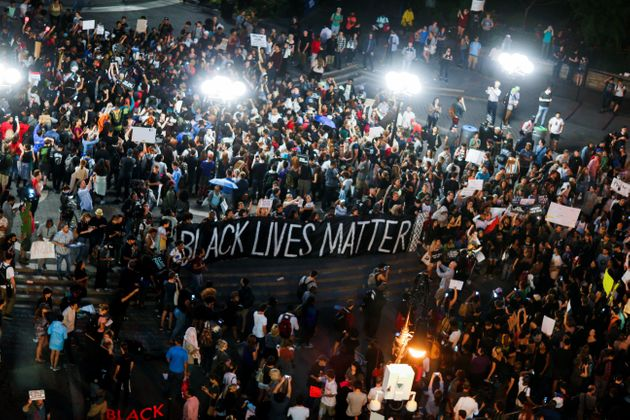 People take part in a protest against police brutality and in support of Black Lives Matter during a...