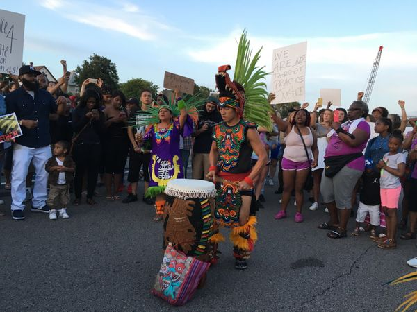 A member of the indigenous Mexican Mexica Tribe from the Kalpulli Yaocenoxtli dance group drums on I-94 during a protest take