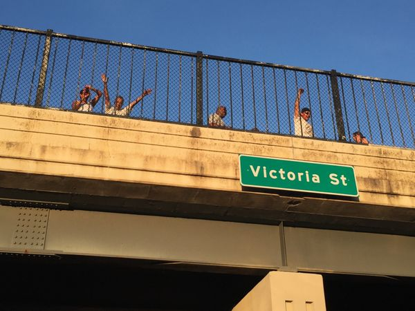 Onlookers from the Victoria Street pedestrian bridge cheer at protestors down below who took over I-94 on July 9.