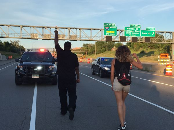 Protesters enter onto eastbound I-94 before taking both lanes during a march on July 9.
