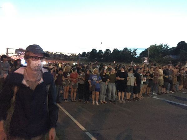 Protesters don masks and bandanas in anticipation of tear gas orpepper spray after St. Paul police warn of use of force