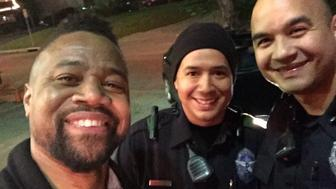 Actor Cuba Gooding Jr. is seen posing for a photo with Dallas police officer Patrick Zamarripa and his partner back in February.