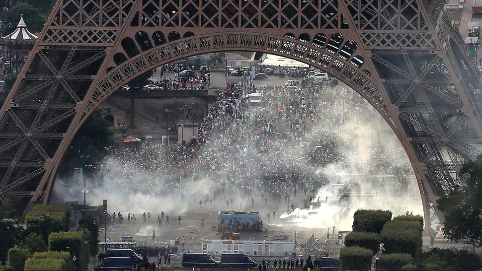 A picture taken from the Tour Montparnasse shows tear gas under the Eiffel Tower.