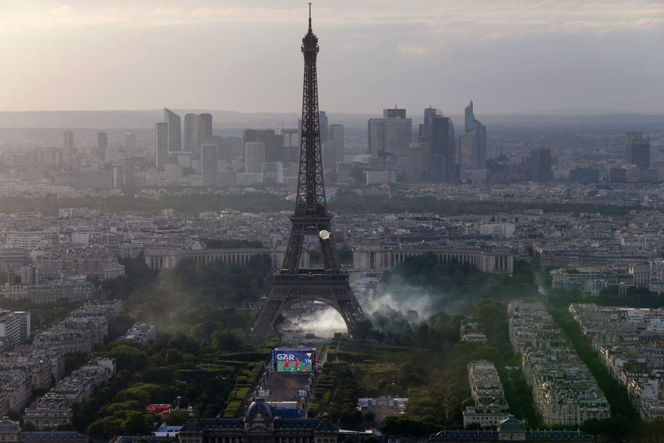 A picture taken from the Tour Montparnasse shows tear gas under the Eiffel Tower during clashes between police and supporters