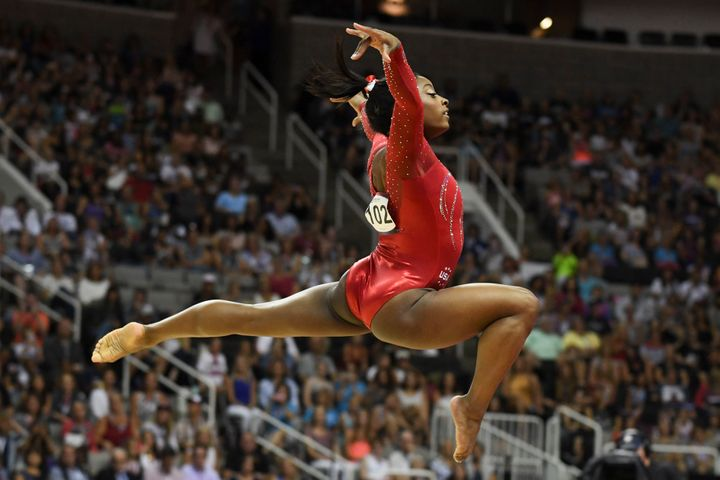 Simone Biles, shown here in the floor exercise, is heading to the Olympics for the first time.