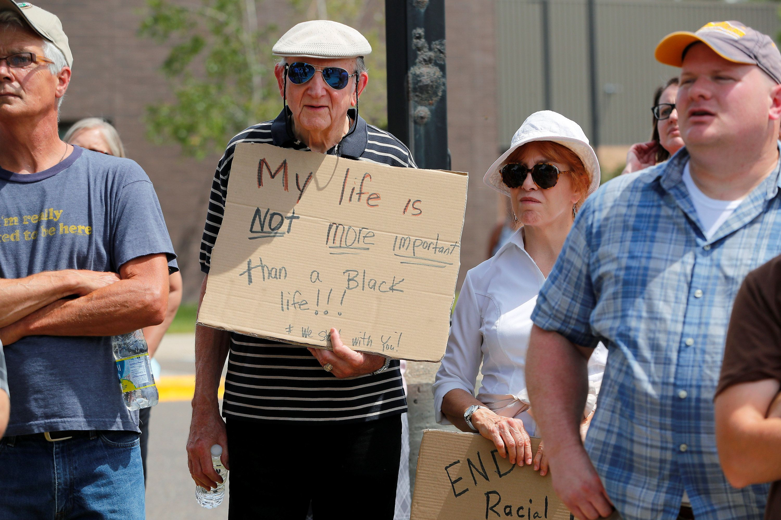 Demonstrators protesting the shooting death of Philando Castile gather in front of the police department in St. Anthony, Minn