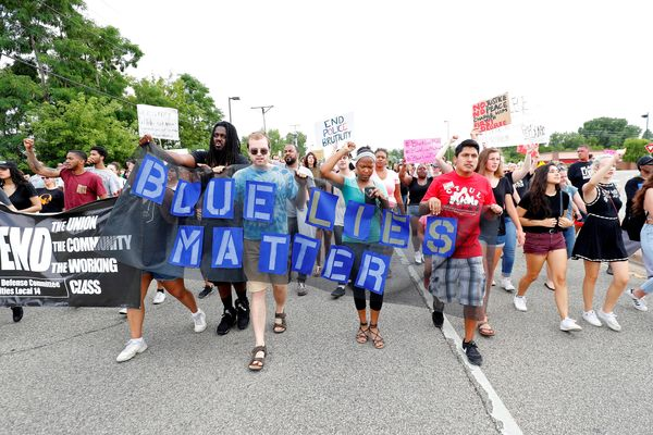 Demonstrators protesting the shooting death of Philando Castile marchin front of the police department in St. Anthony,