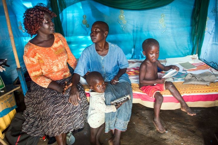 HIV counsellor Angelina Dwoki (L) interacts with one of her patients, Rose Koluwa (R), an HIV positive mother of six boys and