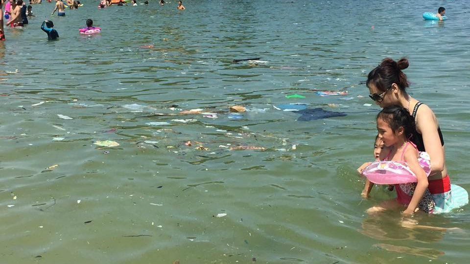 Trash floats in the waters of one of Hong Kong's