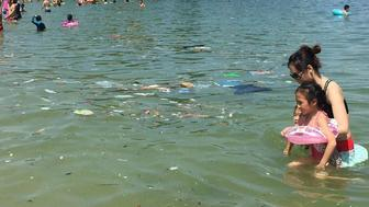 Trash floats in the waters of one of Hong Kong's beaches.