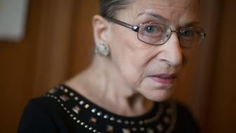 Ruth Bader Ginsburg, associate justice of the U.S. Supreme Court, stands for a photograph in her chambers following an interview in Washington, D.C., U.S., on Friday, Aug. 23, 2013. Ginsburg, 80, the oldest member of the Supreme Court and appointed to the court in 1993 by Democratic President Bill Clinton, has said on several occasions that she wants to match the longevity of Justice Louis Brandeis, who was 82 when he stepped down in 1939. Photographer: Andrew Harrer/Bloomberg via Getty Images