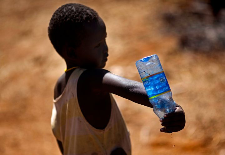 NARIMETO, KENYA - FEBRUARY 03: Water shortage in North Kenya, an infant is spilling the last water drops out of a bottle. (Ph